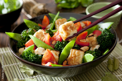 Closeup of a bowl of tofu and vegetable stir fry. - 58310995
