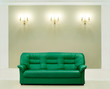 The green leather sofa, is put about a wall with candelabrums