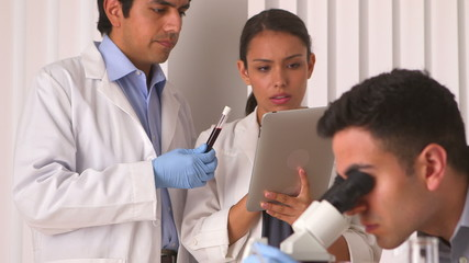 Hispanic scientists doing blood tests in the lab