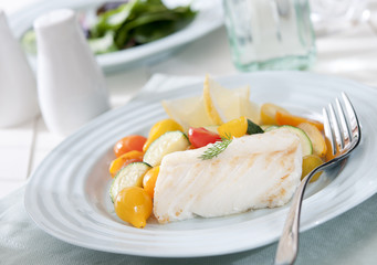 healthy lunch with fresh cod and steamed vegetables.