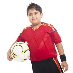 Boy carrying a soccer ball