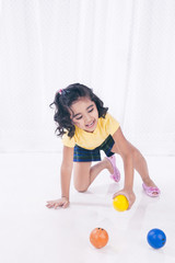 Girl playing with balls