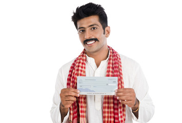 Portrait of a man showing a bank cheque and smiling