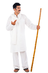 Man holding a wooden staff and gesturing