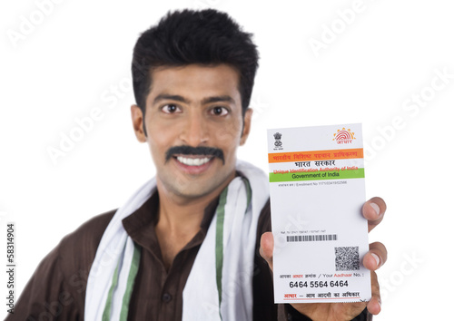 Portrait of a man showing Aadhar Card