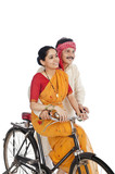 Couple riding a bicycle