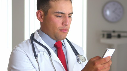 Mexican doctor  using smartphone