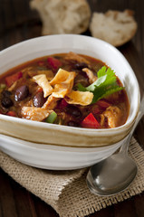 Closeup of a spicy chicken tortilla soup.