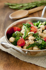 healthy salad with broccoli, garbanzo beans and tomato.
