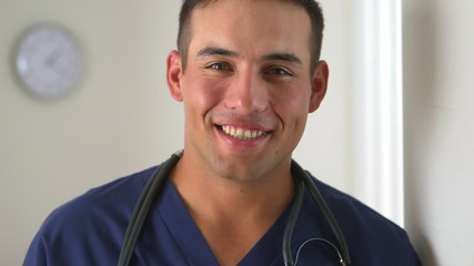 Hispanic doctor smiling in medical office