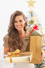 Portrait of happy young woman christmas present boxes