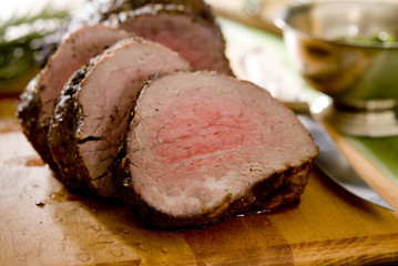 Closeup of sliced tenderloin roast beef.