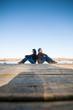 Couple sitting near water