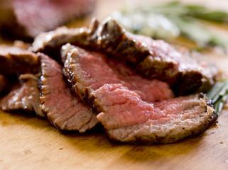 Closeup of slices of rare tenderloin steak.