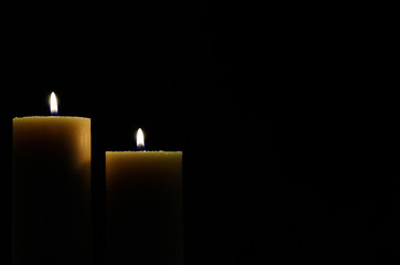 two candles with dark background