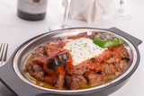 Traditional Turkish Bursa Iskender Kebap Garnished with Grilled
