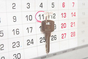 A house key on a calendar background,