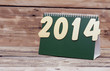 desk calendar with gold numbers 2014 on old wooden table