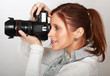 Beautiful young woman with camera.
