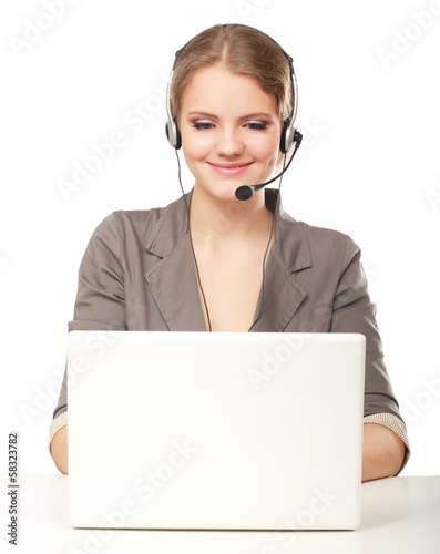 Portrait of businesswoman working with headset and laptop.