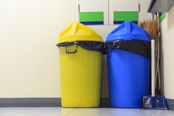 Large yellow and blue trash