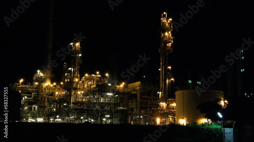 Oil refinery factory at night, Chonburi, Thailand.