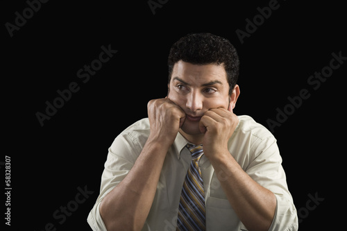 Businessman waiting with his head in hands