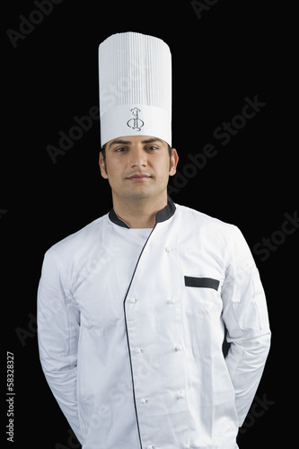 Portrait of a chef standing with hands behind back