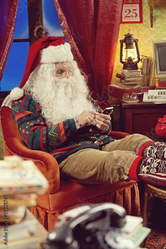 Santa Claus and smartphone