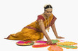 South Indian woman making rangoli