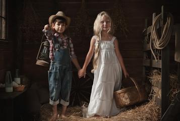 Portrait of children in a rustic barn