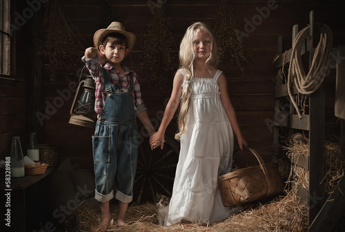 Portrait of children in a rustic barn