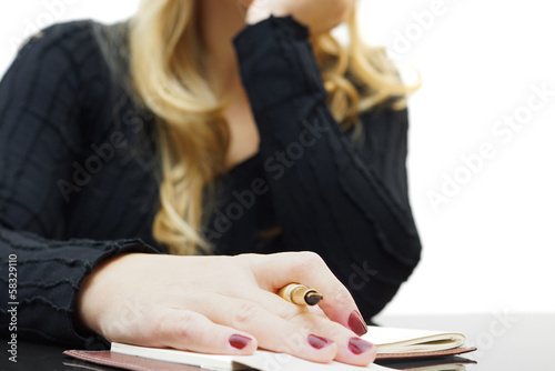 female sitting on a boring lecture