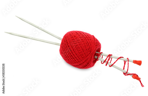 Red ball of yarn with knitting