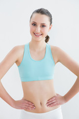 Smiling toned woman in fitness studio
