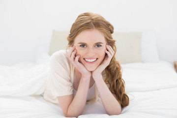Close up of a pretty young woman in bed