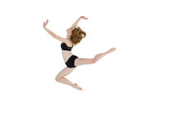 Side view of a sporty young woman jumping