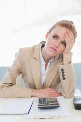 Worried businesswoman sitting at office desk
