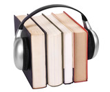 Close-up of books with headphones