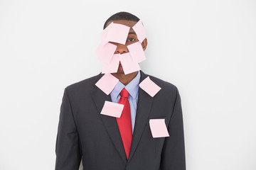 Portrait of an Afro businessman covered in blank notes