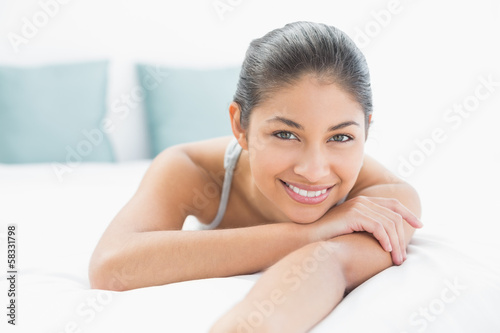 Portrait of a pretty woman lying in bed