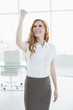 Cheerful elegant businesswoman cheering in office