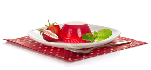 Plate with jelly, slices of strawberry and mint