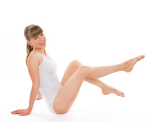 Joyful body care girl after legs waxing, isolated on white