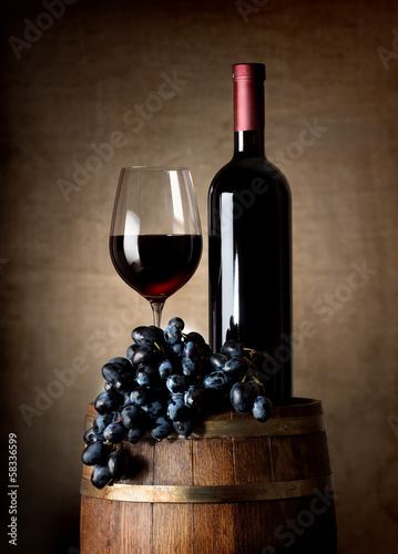 Red wine with barrel and grapes