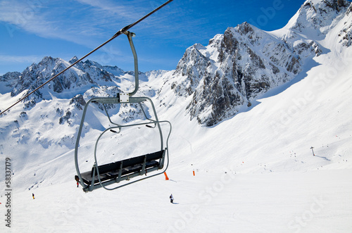 Aerial lift in the winter mountains