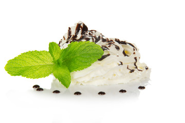 Whipped cream is decorated by spearmint and the chocolate