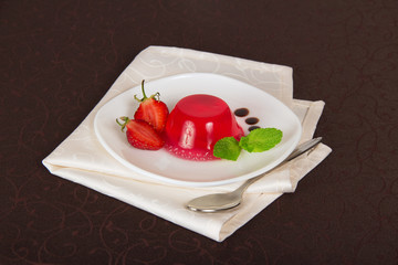 Drops of chocolate and strawberry on a plate from jelly