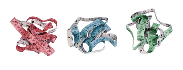 Close-up of three tangled tape measures