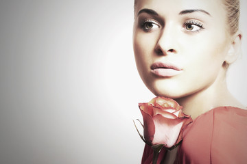 girl and flower.beautiful woman in red dress.fresh rose.close-up